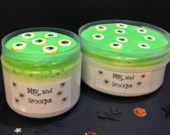 Milk and Spookies - Cereal Milk Slime with clay disc and fimo eyeballs.
