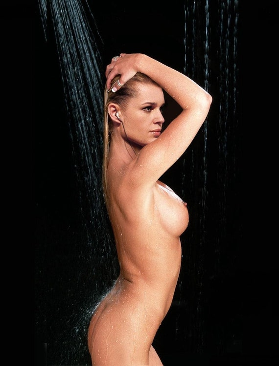 rebecca-romijn-naked-and-sucking-cock
