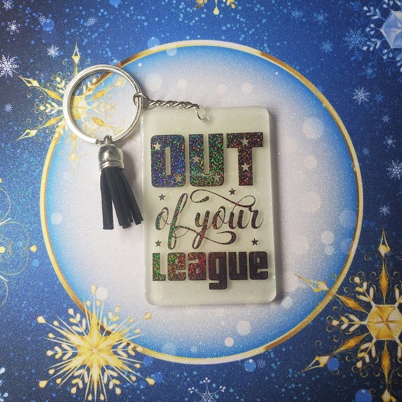 Out of your League Keychain glows in the dark image 0