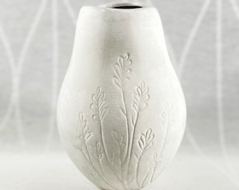 Small White Ceramic Vase with Carved Floral Design