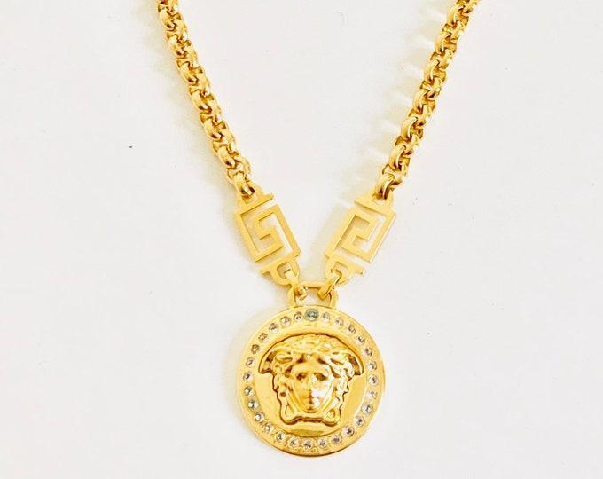 Featured listing image: OPULENT vintage Versace Medusa pendant gold plated necklace encrusted with Swarovski crystals