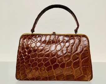 TIMELESS brown patent leather top handle handbag with pressed crocodile patterns