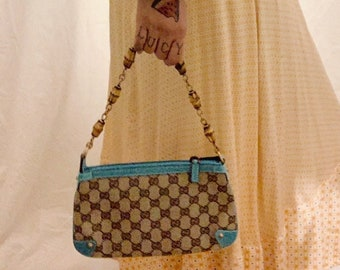 NOSTALGIC vintage 90s Gucci bamboo mini handbag in monogram cloth and turquoise leather details perfect condition