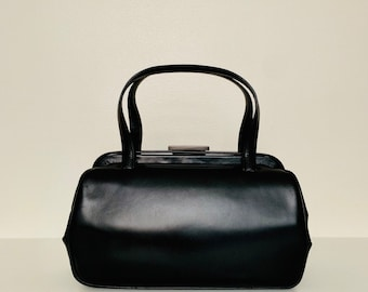 UNIQUE vintage 90s Prada black leather top handle bag with authentication card and dustbag