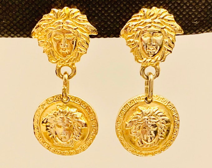 Featured listing image: EXTRAVAGANT vintage Gianni Versace Medusa gold plated clip on earrings