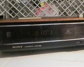 one Sony Digimatic Lifetime flip alarm clock. With radio But no backlight because I 39 m stupid Read on