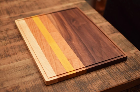 Striped hardwood cutting board with juice groove. Beautiful serving tray.