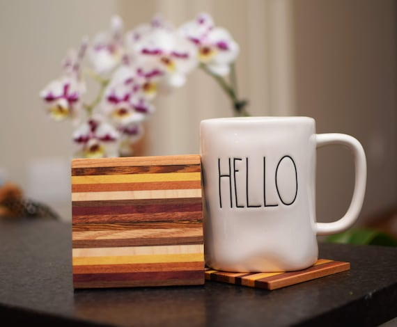 Various hard wood laminate coaster set. Four handmade wood coasters. Mix of domestic and exotic hard woods. Colorful and classy drink holder