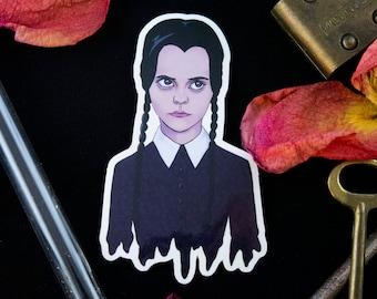 "Wednesday Addams Sticker, Addams Family Sticker - Vinyl Sticker - Halloween Sticker - Spooky Sticker (3"" x 1.8"")"