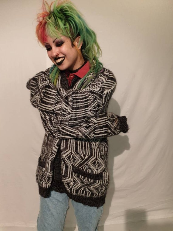 Oversized wool cardigan with pockets.