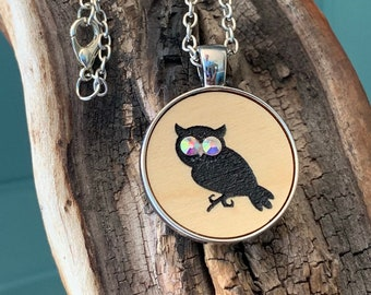 Halloween owl with silver tone metal pendant necklace. Spooky black night bird with rhinestone eyes- laser cut Gothic wooden circle jewelry.