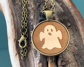 Classic Halloween little ghost with antique bronze gold tone metal charm and necklace.  Laser cut classy maple wood jewelry. Spooky & cute.