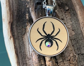 Halloween black widow spider with rhinestone, silver tone metal  necklace, Spooky insect, laser cut, Gothic Goth wooden circle charm jewelry