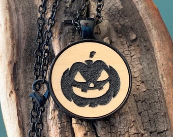 Halloween black Jack-O-lantern metal pendant necklace with chain.  Spooky pumpkin on laser cut Maple wood inserted into Gothic goth jewelry.