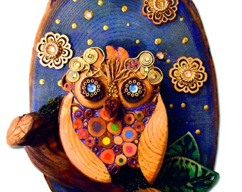 Owl on wood section