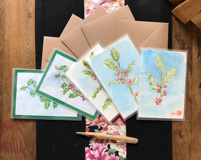 Hand-painted holly-themed cards, delivered with envelope.