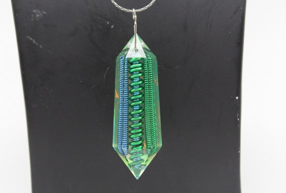 Mantis Coil - Bold Blue and Green Coils sealed inside this Elongated Gem Crystal with Iridescent Foil Back - Double Terminated Shape