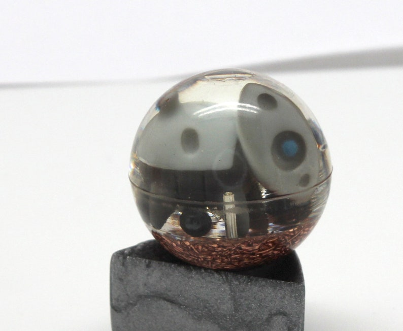 1.1 inch sphere with copper and metal bits it is chewing on Aron Steel Pokemon Gen 3 Marble Desktop Display Piece PoGo Evolves to Aggron