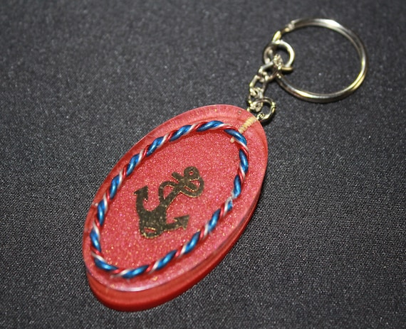 Anchor with Red White and Blue Twisted Wire on Red Background - Spectrum Harmonizer Made for You