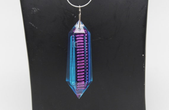 Nagle - Like an 80's City Night - Blue Coils sealed inside this Elongated Gem Crystal with Iridescent Foil Back - Double Terminated Shape