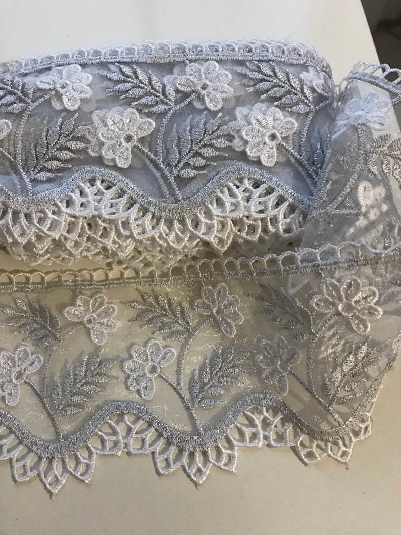 White and silver embroidered lace metallic grey and white lace