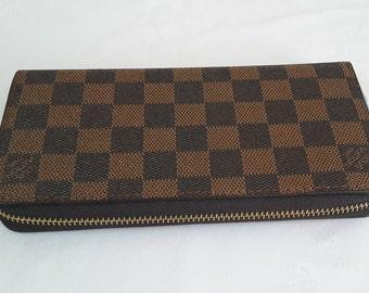 b868841baab7 LOUIS VUITTON Grid Zippy wallet