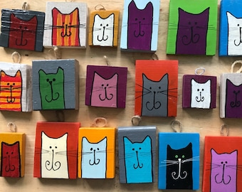 Quirky wooden wall hangings, cats, aardvarks, mice, hedgehogs