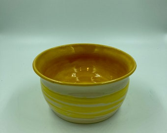 Yellow pottery bowl