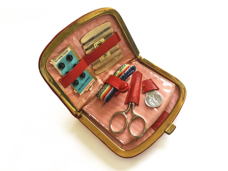 Vintage sewing kit in red leather case