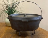 WENZEL 1887 Cast Iron Dutch Oven Roaster (Camping) With Lid. Trivet And Carry Bag Included.