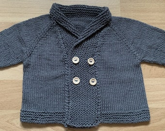 hand-knitted dark grey baby jacket double-breasted with shawl collar and four buttons
