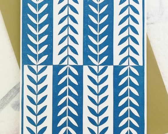 Blue linocut leaf pattern card