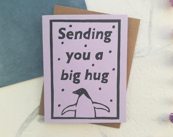 Handprinted linocut penguin hug greeting card - assorted colors