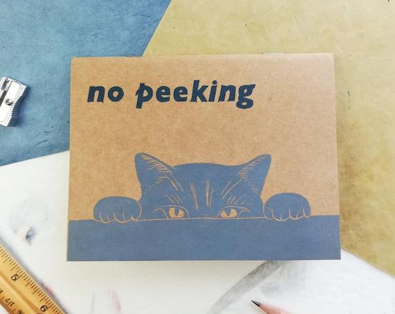 Handprinted no peeking cat notebook
