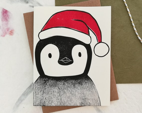 Handprinted linocut penguin holiday card