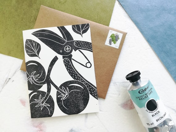 Handprinted tomatoes on the vine linocut card
