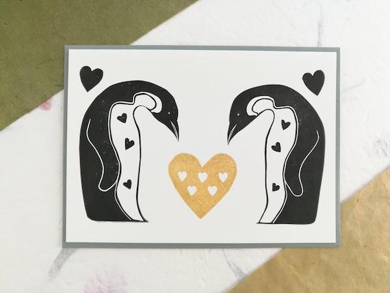 Handprinted linocut penguins in love card