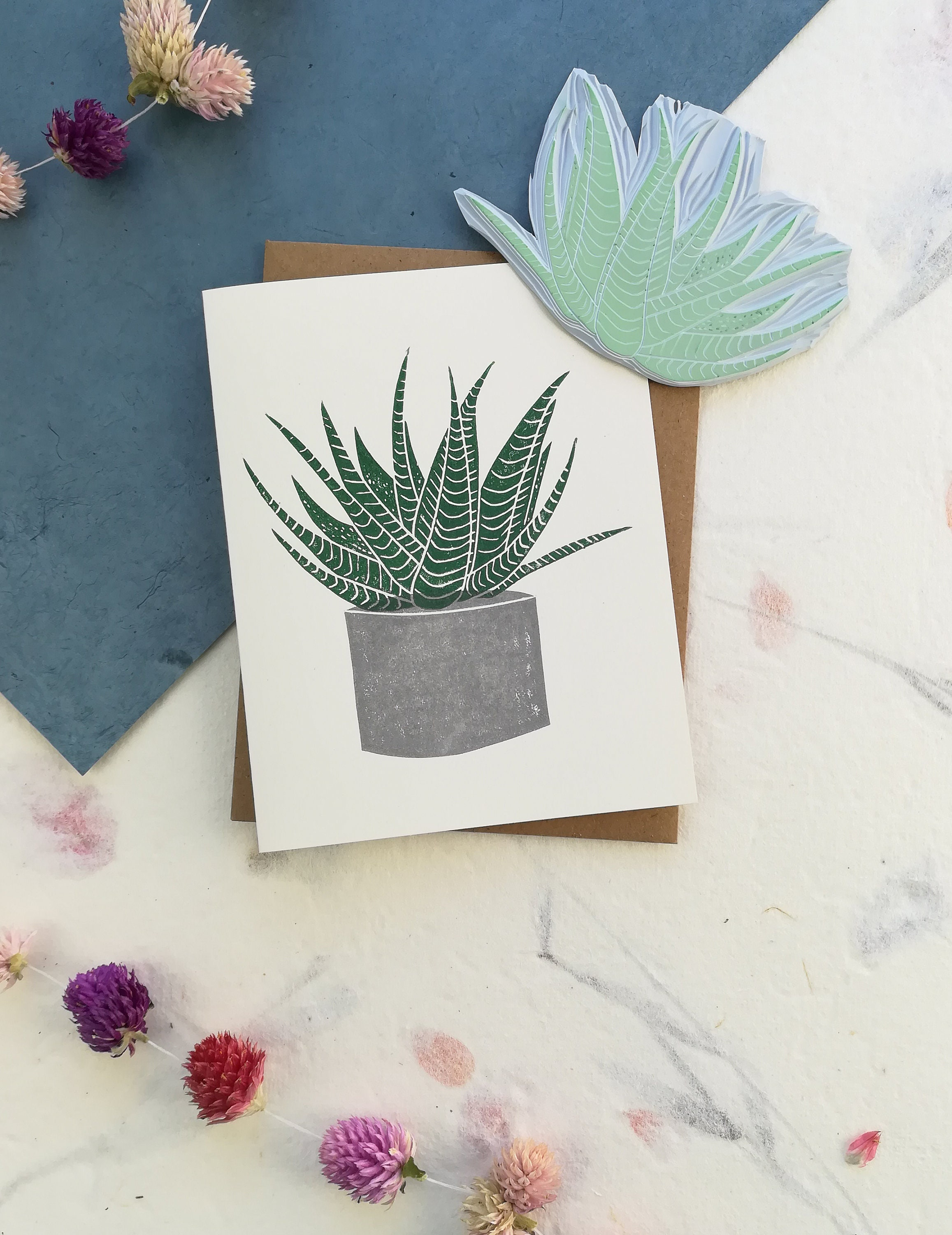 Handprinted card with potted flowers and cactus