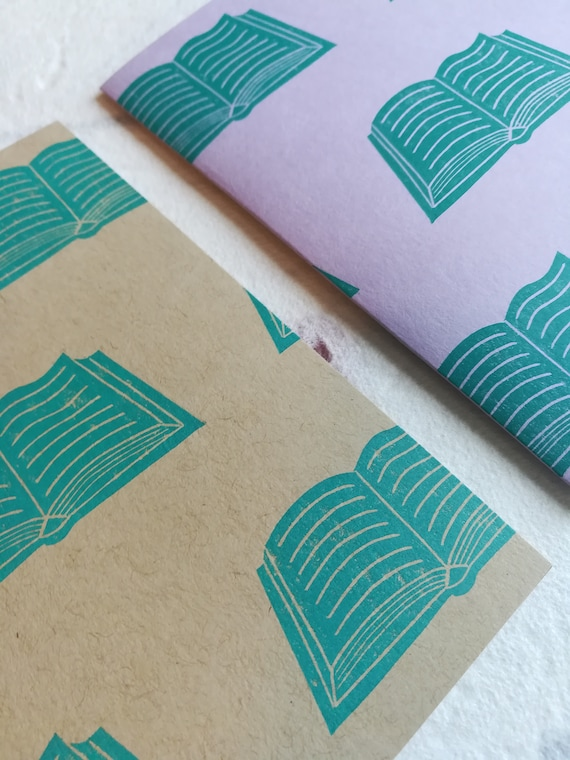 Handprinted linocut open book card