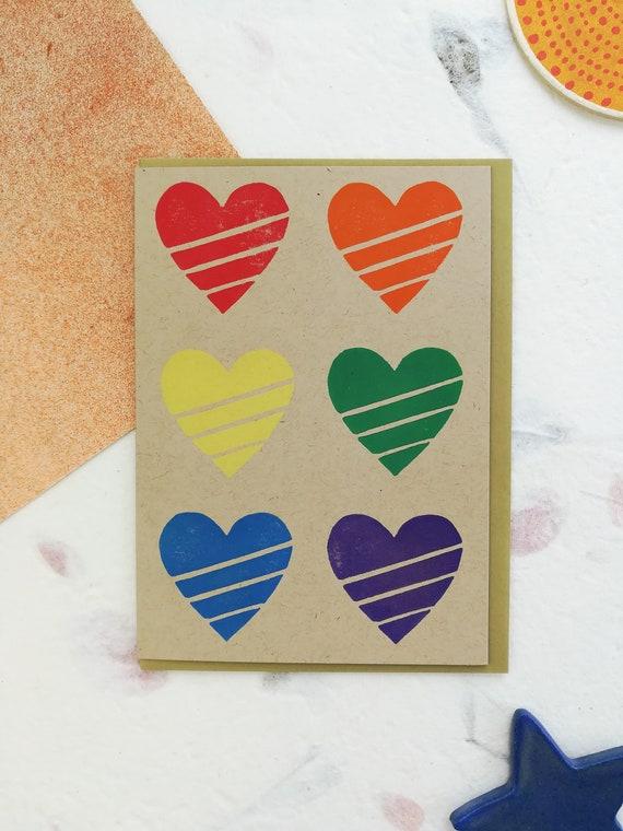 Handprinted linocut rainbow hearts card