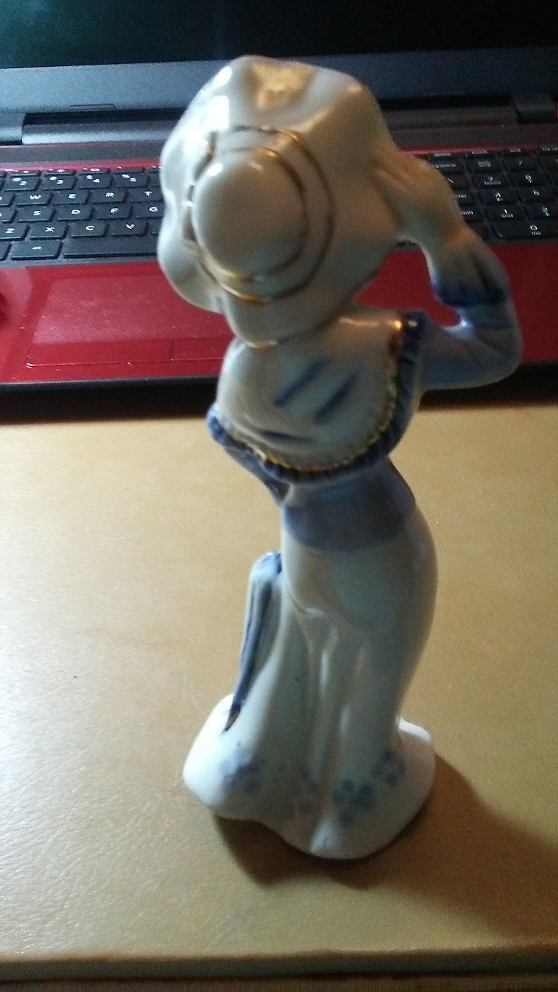 Vintage Hand Painted Porcelain Statue Lady with Her Hat and Umbrella Figurine.