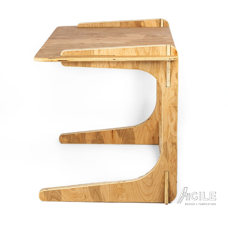 The AGILE DESK is a custom dimension writing and computer desk that/'s light and elegant yet super strong and durable
