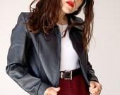 Vintage 90s long sleeve zip faux snake leather black jacket.