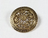 Vintage gold tone filigree brooch, round openwork pin with fleurs-de-lis