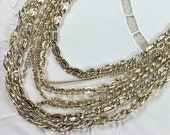 Vintage Arthur Pepper light gold tone multi strand chain necklace, 1960s-70s, signed ART