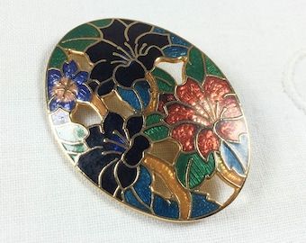 Beautiful vintage oval champlevé floral brooch, teal with black, orange, and blue flowers, unsigned Fish & Crown enamel cloisonné pin