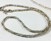 Twisted triple chain necklace, mixed metals