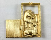Vintage JJ Jonette Jewelry Company brushed gold tone mare and foal brooch with opening and closing door, signed