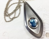 "Vintage Oneida stainless steel pendant with faux abalone on 26"" chain, Sheffield, England, 1960s"
