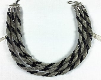 """3-strand choker, twisted silver tone mesh with black cut glass beads, 15"""", 1950s-60s"""